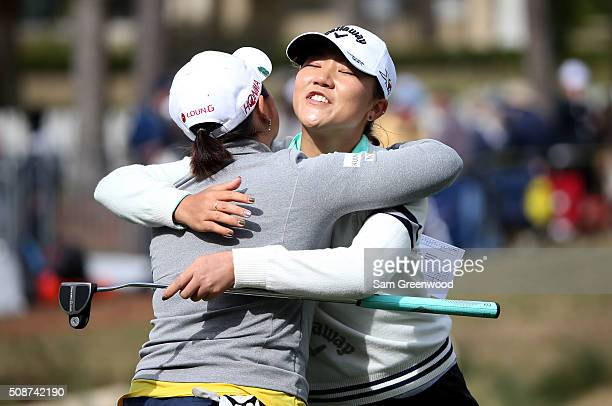 Lydia Ko of New Zealand hugs Ha Na Jang of South Korea on the 18th hole following the continuation of the third round of the Coates Golf Championship...