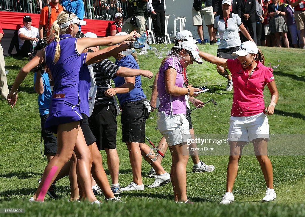 Lydia Ko of New Zealand is giving a water shower by fellow players following her five stroke victory during the final round of the CN Canadian Women's Open at Royal Mayfair Golf Club on August 25, 2013 in Edmonton, Alberta, Canada.