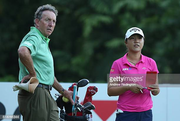 Lydia Ko of New Zealand is pictured with her coach David Leadbetter during the Pro Am event prior to the start of the HSBC Women's Champions at...
