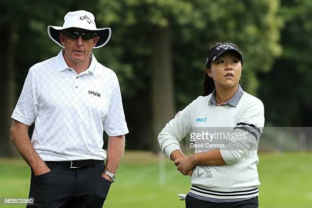Lydia Ko of New Zealand is watched by her Coach David Leadbetter during a ProAm round ahead of the Ricoh Women's British Open at Woburn Golf Club on...