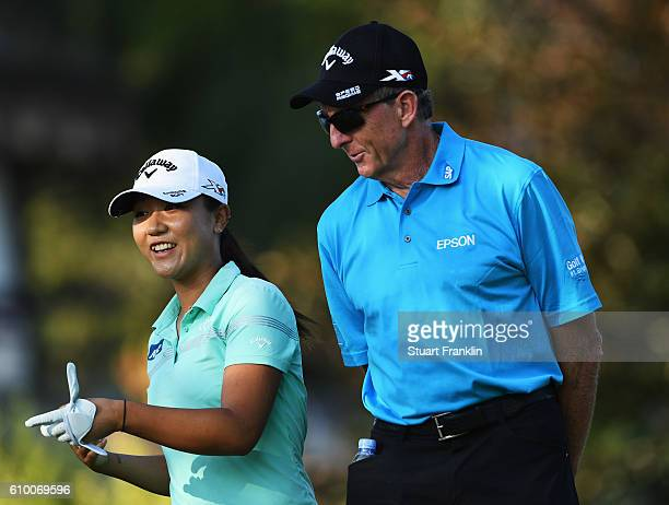 Lydia Ko of New Zealand jokes with her coach David Leadbetter prior to the start of the Evian Championship Golf on September 14, 2016 in...