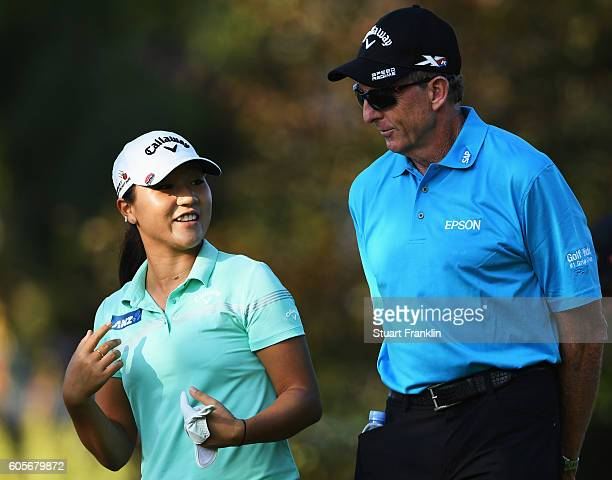 Lydia Ko of New Zealand jokes with her swing coach David Leadbetter during practice prior to the start of the Evian Championship Golf on September 14...