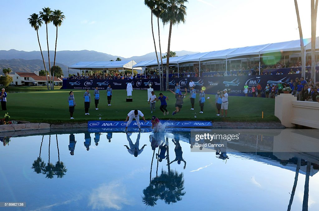 Lydia Ko of New Zealand leads the leap into Poppie's Pond at the 18th green after her victory in the final round of the 2016 ANA Inspiration at the Mission Hills Country Club on April 3, 2016 in Rancho Mirage, California.