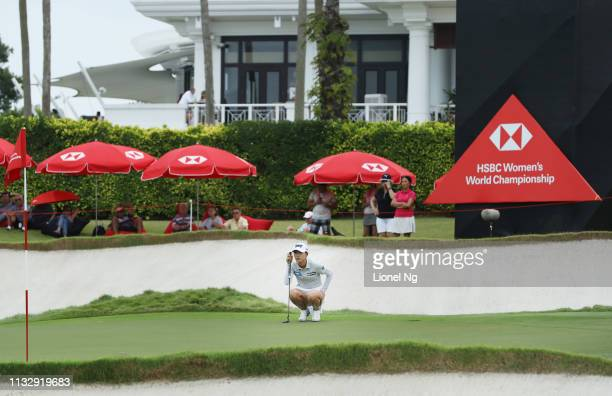 Lydia Ko of New Zealand lines up a putt on the 18th green during the second round of the HSBC Women's World Championship at Sentosa Golf Club on...