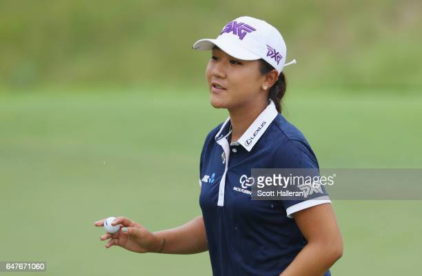 Lydia Ko of New Zealand makes birdie on the eighth hole during the third round of the HSBC Women's Champions on the Tanjong Course at Sentosa Golf...
