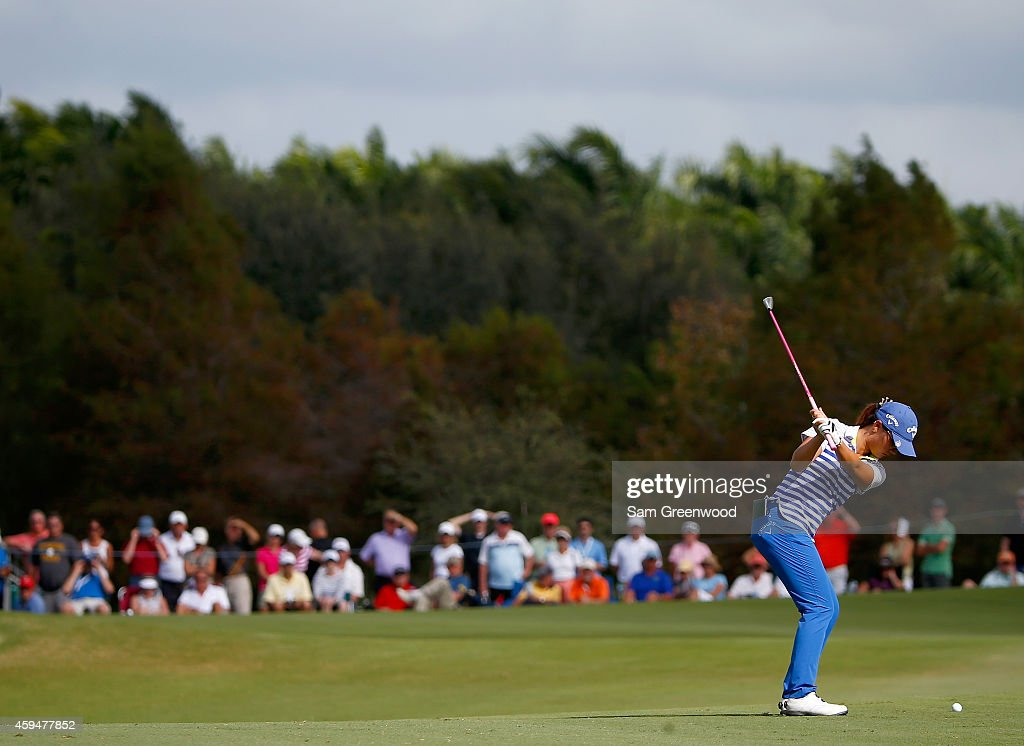 Lydia Ko of New Zealand plays a shot on the 13th hole during the final round of the CME Group Tour Championship at Tiburon Golf Club on November 23, 2014 in Naples, Florida.