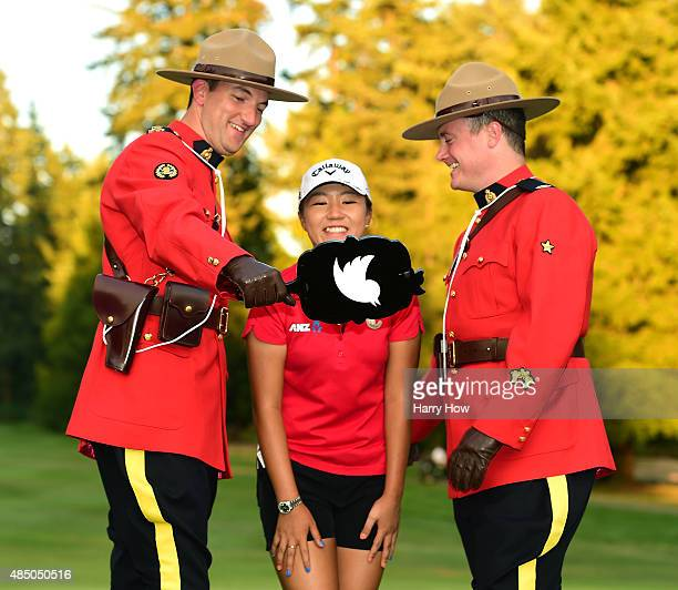 Lydia Ko of New Zealand poses for a photo with the Royal Canadian Mounted Police after her victory during the final round of the Canadian Pacific...
