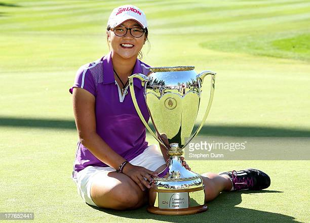 Lydia Ko of New Zealand poses with her trophy following her five stroke victory during the final round of the CN Canadian Women's Open at Royal...