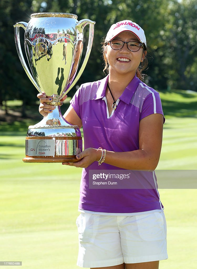 Lydia Ko of New Zealand poses with her trophy following her five stroke victory during the final round of the CN Canadian Women's Open at Royal Mayfair Golf Club on August 25, 2013 in Edmonton, Alberta, Canada.