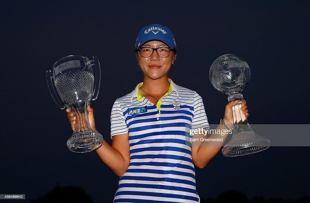 Lydia Ko of New Zealand poses with the CME Tour Championship trophy and the CME Race for the Globe trophy following the final round of the CME Group Tour Championship at Tiburon Golf Club on November 23, 2014 in Naples, Florida.