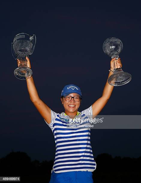 Lydia Ko of New Zealand poses with the CME Tour Championship trophy and the CME Race for the Globe trophy following the final round of the CME Group...