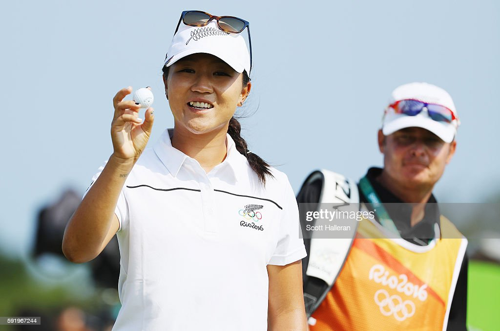 Lydia Ko of New Zealand poses with the golf ball she used to make a hole-in-one on the eighth hole during the third round of the Women's Individual Stroke Play golf on Day 14 of the Rio 2016 Olympic Games at Olympic Golf Course on August 19, 2016 in Rio de Janeiro, Brazil.