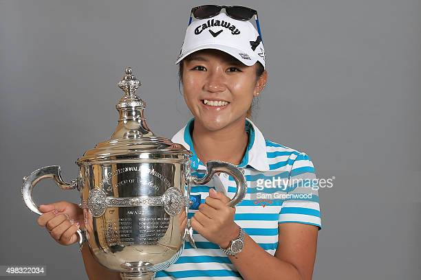 Lydia Ko of New Zealand poses with the Rolex Player of the Year trophy during the final round of the CME Group Tour Championship at Tiburon Golf Club...