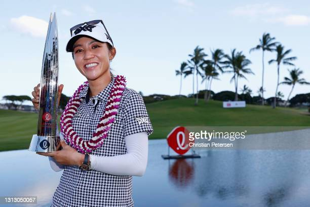 Lydia Ko of New Zealand poses with the trophy after winning the LPGA LOTTE Championship at Kapolei Golf Club on April 17, 2021 in Kapolei, Hawaii.
