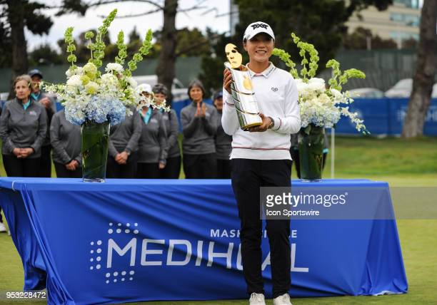 Lydia Ko of New Zealand poses with the trophy after winning the tourmanet during the final round of the Mediheal Championship on April 29 2018 at...