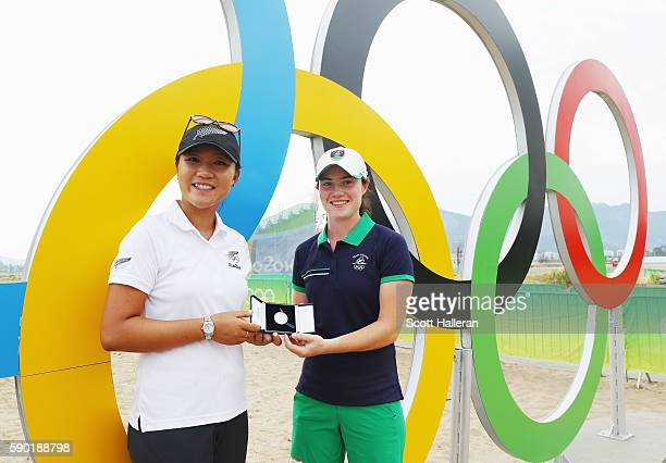 Lydia Ko of New Zealand presents Irelands Leona Maguire the Mark H McCormack Medal after a practice round prior to the start of the women's golf...