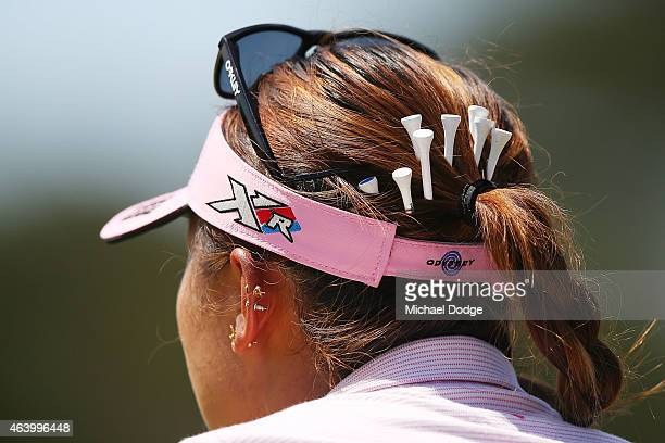 Lydia Ko of New Zealand puts tees in her hair to use later during day three of the LPGA Australian Open at Royal Melbourne Golf Course on February 21...