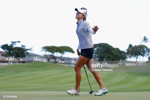 Lydia Ko of New Zealand reacts after her final putt on the 18th green to win the LPGA LOTTE Championship at Kapolei Golf Club on April 17, 2021 in...