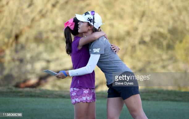 Lydia Ko of New Zealand shakes the hand of a member of the LPGAUSGA Girls Golf of Phoenix after completing her round during the final round of the...