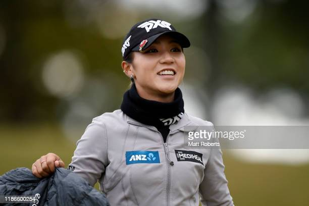 Lydia Ko of New Zealand smiles after her tee shot on the 1st hole during the final round of the TOTO Japan Classic at Seta Golf Course North Course...