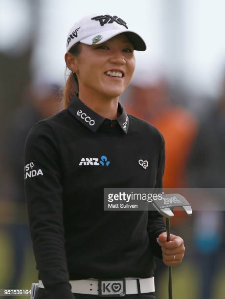 Lydia Ko of New Zealand smiles after making a birdie putt on the 16th hole during the third round of the Mediheal Championship at Lake Merced Golf...