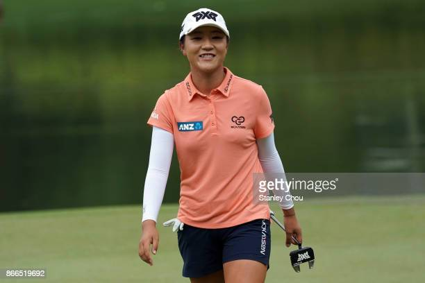 Lydia Ko of New Zealand smiles on the 18th hole after completion of her play to the top of the leaderboard during day one of the Sime Darby LPGA...