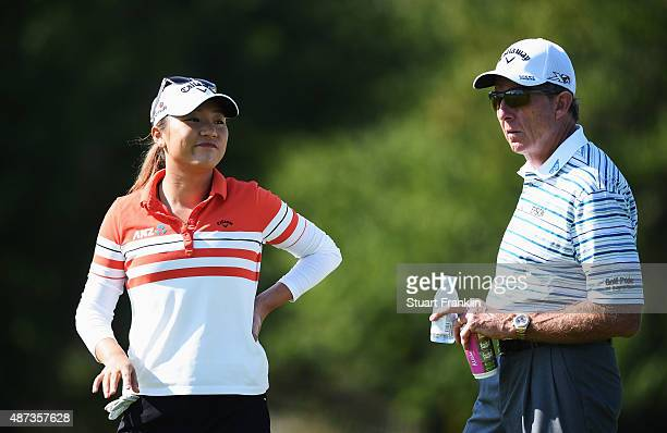 Lydia Ko of New Zealand talks with golf coach David Leadbetter during practice prior to the start of the Evian Championship Golf on September 9 2015...
