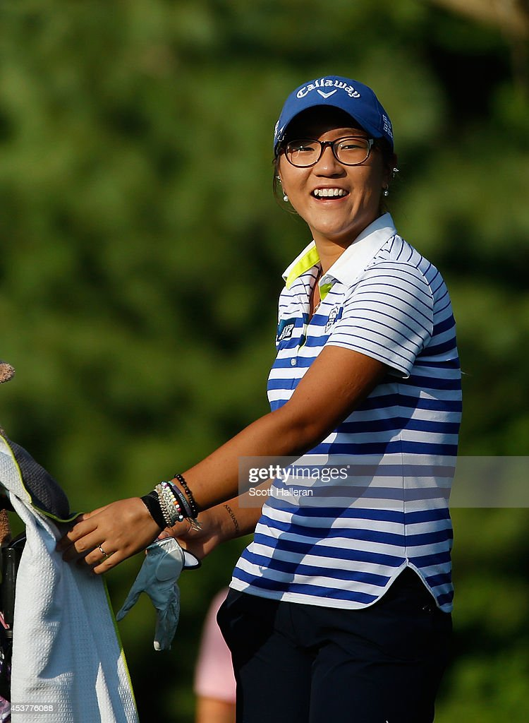 Lydia Ko of New Zealand waits on the 16th hole during the final round of the Wegmans LPGA Championship at Monroe Golf Club on August 17, 2014 in Pittsford, New York.