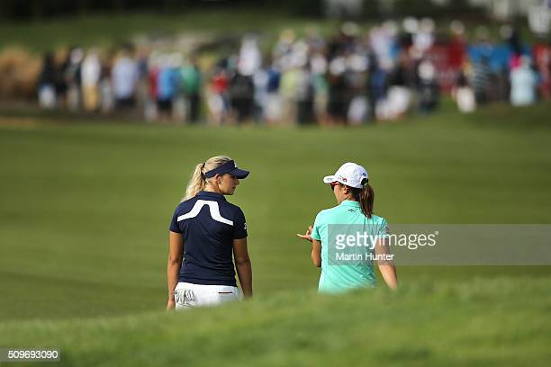 Lydia Ko of New Zealand walks the 15th fairway with Emily Pedersen of Denmark during the 1st round of the New Zealand Women's Open at Clearwater Golf...