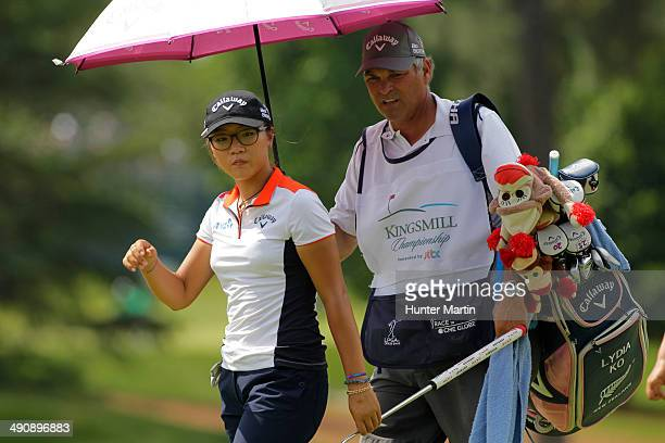 Lydia Ko of New Zealand walks with her caddie on the first green during the first round of the Kingsmill Championship presented by JTBC on the River...