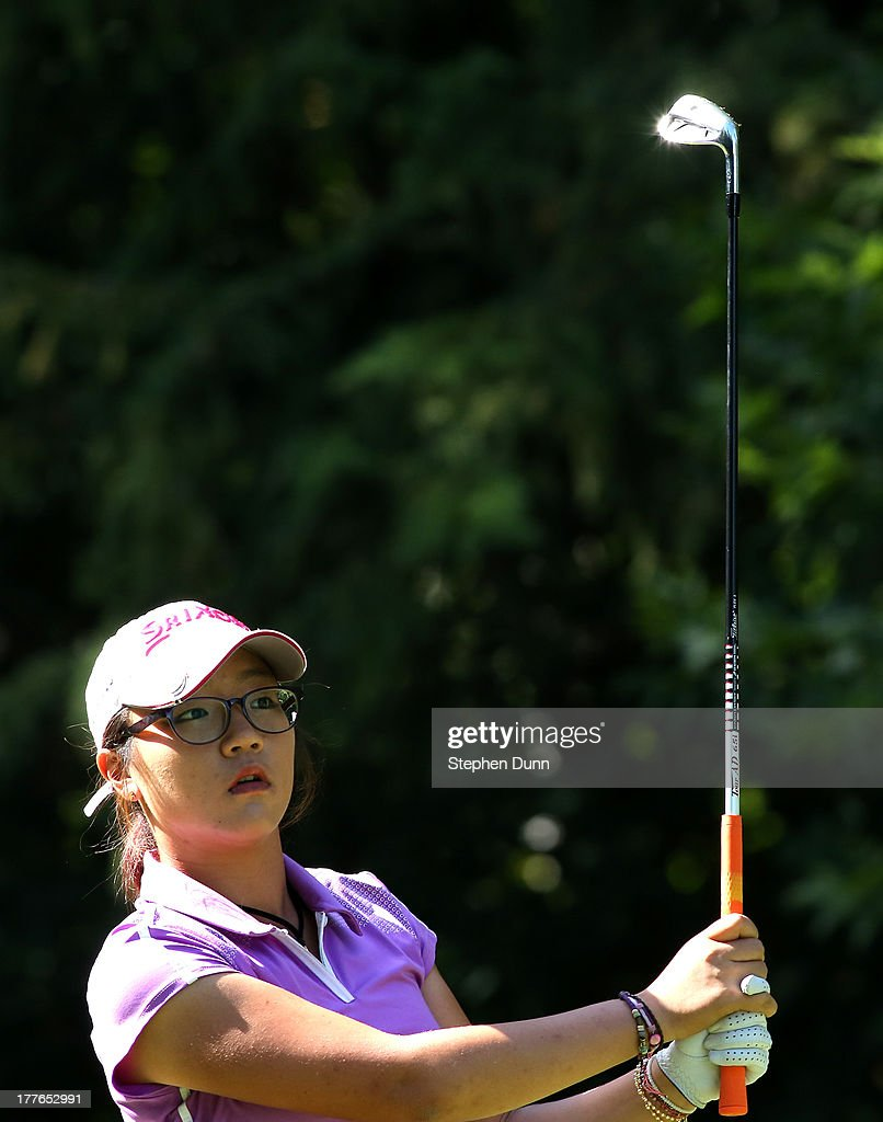 Lydia Ko of New Zealand watches her tee shot on the 16th hole during the final round of the CN Canadian Women's Open at Royal Mayfair Golf Club on August 25, 2013 in Edmonton, Alberta, Canada.