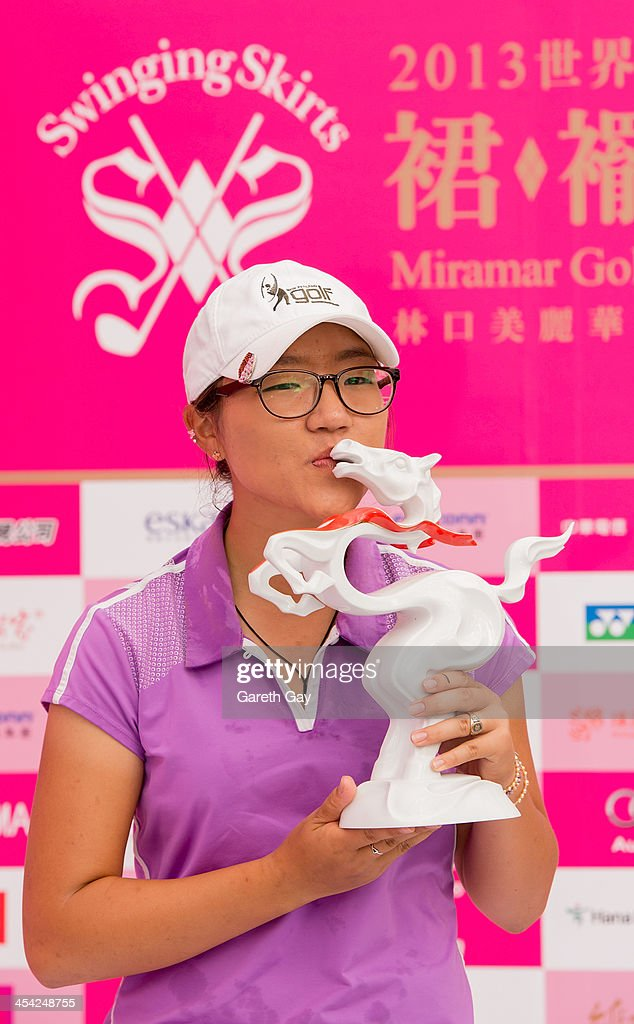 Lydia Ko of New Zealand, with the winning score of Eleven under par, kisses her 2013 Swinging Skirts World Ladies Masters trophy, during the last day of the Swinging Skirts 2013 World Ladies Masters, at Miramar Golf & Country Club on December 8, 2013 in Taipei, Taiwan.