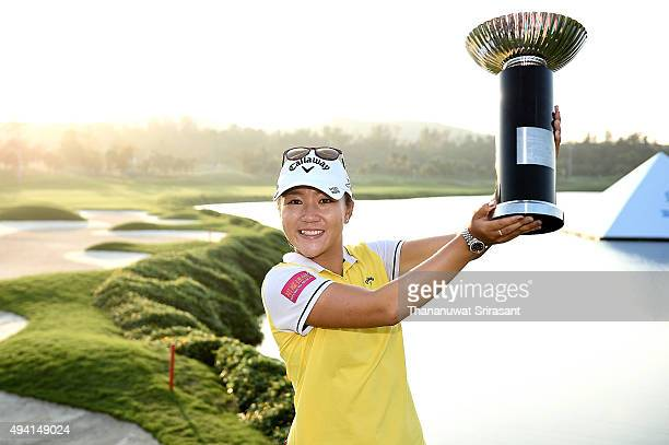 Lydia Ko poses with the trophy on the 18th green after winning 2015 Fubon LPGA Taiwan Championship on October 25, 2015 in Miramar Resort & Country...