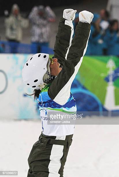 Lydia Lassila of Australia celebrates on the way to winning the gold medal during the freestyle skiing ladies' aerials final on day 13 of the...
