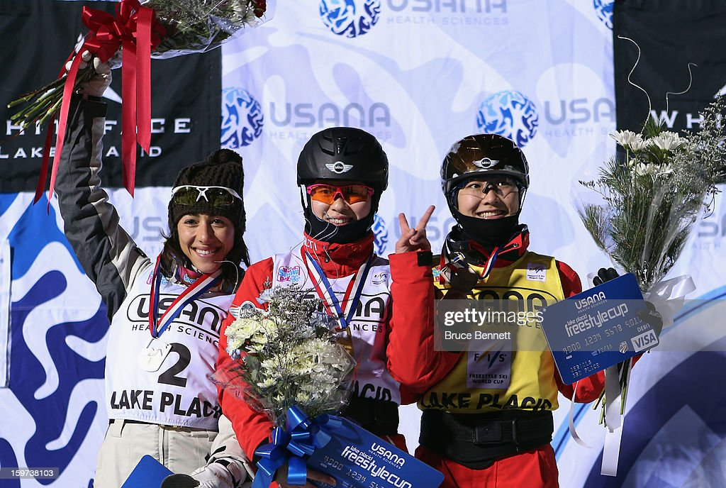 Lydia Lassila #2 of Australia (second place), Yu Tang #3 of China (first place) and Mengtao Xu #1 of China (second place take the podium after the USANA Freestyle World Cup aerial competition at the Lake Placid Olympic Jumping Complex on January 19, 2013 in Lake Placid, New York.