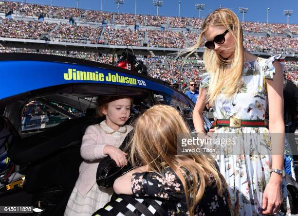 Lydia Norriss and Genevieve Johnson daughters of Jimmie Johnson driver of the Lowe's Chevrolet and mother Chandra Johnson participate in prerace...