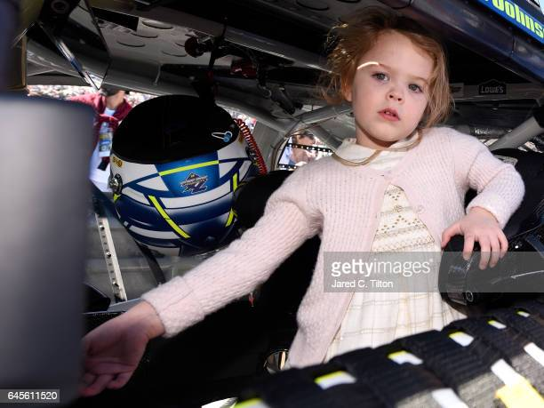 Lydia Norriss daughter of Jimmie Johnson driver of the Lowe's Chevrolet poses in her father's car before the 59th Annual DAYTONA 500 at Daytona...