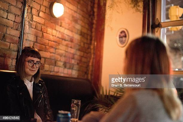 Lydia Pawlowsky has a conversation with her friends at Loveless Cafe and Bar