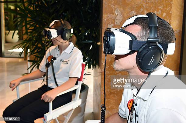 Lydia Penn and Andrew Penn take a 3D engine journey with the Oculus Riftpowered Gear VR headset at the Penske Wynn Ferrari Showroom at Wynn Las Vegas...
