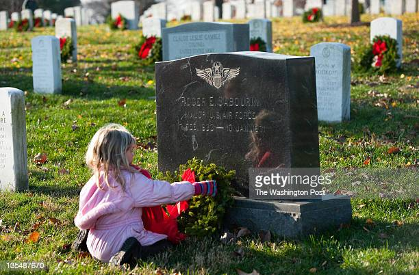 Lydia Sutton of Fairfax Station VA lays a wreath in section 46 on the grave of Roger E Sabourin who died in 1971 Sutton is a member of the American...