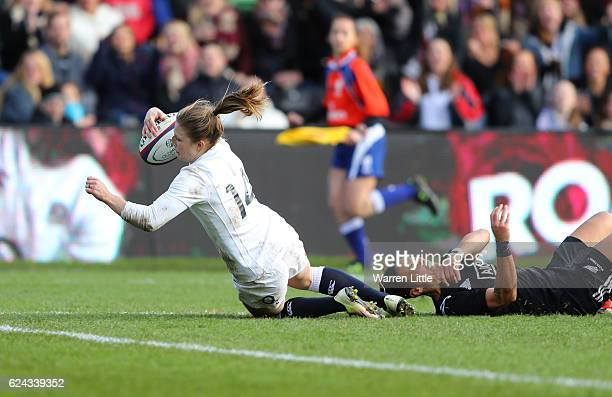 Lydia Thompson of England dives for scoring her team's third try during the Old Mutual Wealth Series Women's match between England and New Zealand at...