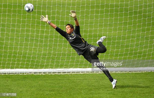 Lydia Williams dives to try and save a shot on goal during an Australian Matildas training session at WIN Jubilee Stadium on August 23 2011 in Sydney...