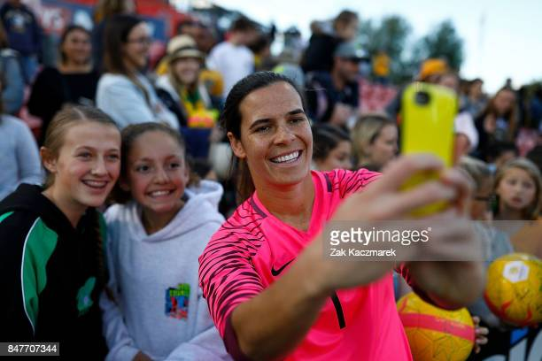 Lydia Williams of Australia takes selfies with fans after Australia defeate Brazil 21 during the women's international match between the Australian...