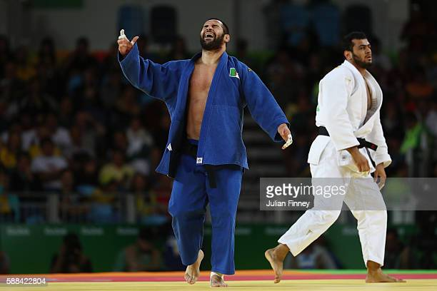 Lyes Bouyacoub of Algeria reacts during the men's 100kg elimination round judo contest against Elmar Gasimov of Azerbaijan on Day 6 of the 2016 Rio...