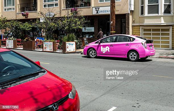 A Lyft branded car service picks up a passenger in San Francisco CA on June 20 2015 The carsharing Lyft continues to expands it services in different...