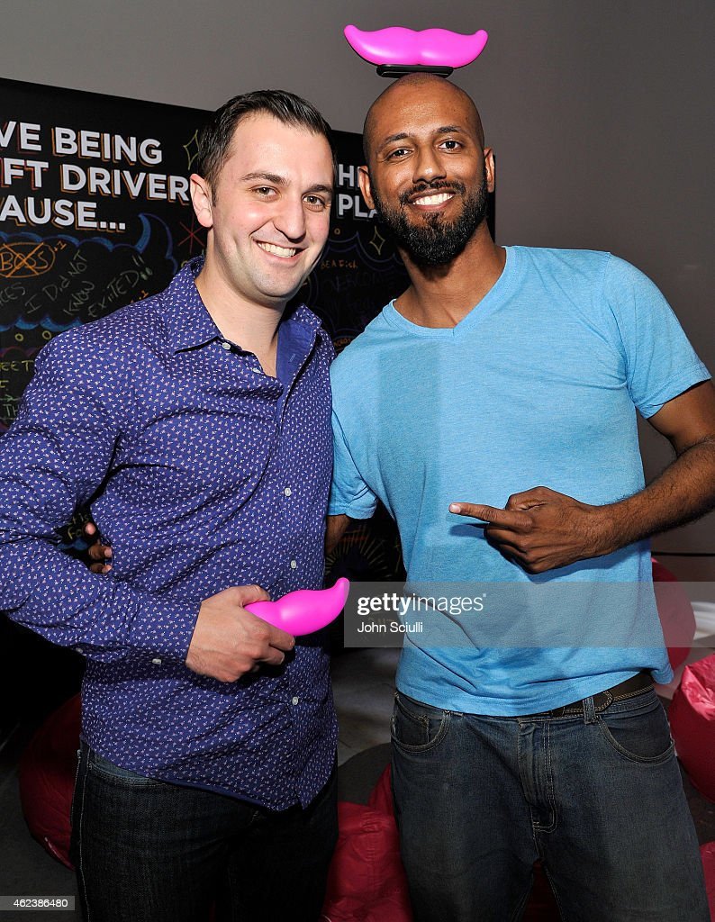 Lyft Co-founder, John Zimmer and Lyft driver Saint Thompson attend the Lyft driver rally at Siren Studios on January 27, 2015 in Hollywood, California.