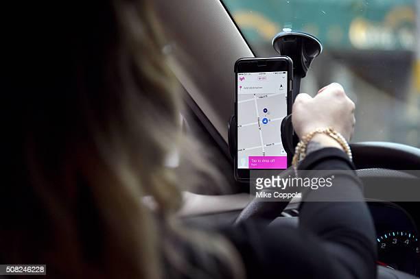 Lyft driver navigates to her passenger on February 3 2016 in San Francisco California