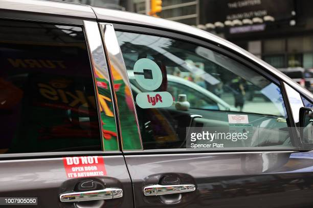 Lyft ride hailing vehicle moves through traffic in Manhattan on July 30 2018 in New York City After a significant increase in local traffic and a...