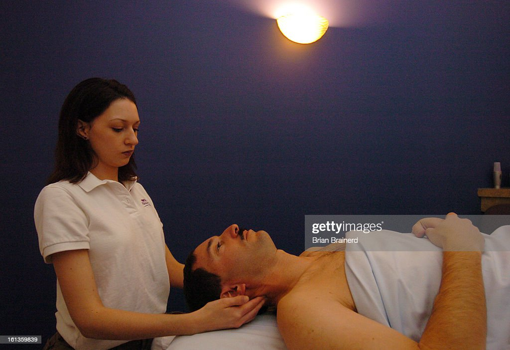 CENTENNIAL, COLORADO -- JANUARY 25, 2006-- Lying down on the job, Larry Reiff, regional franchise developer of Massage Envy, gets a treatment from therapist Bridget Lathrop at one of the Centennial location, 7470-B S. University Blvd.<cq> . (Denver Post S : News Photo