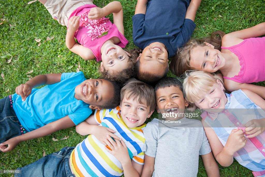 Lying in a Circle in the Grass : Stock Photo